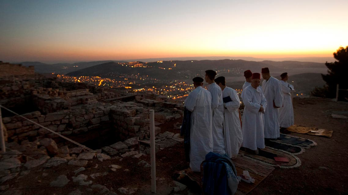 Members of the ancient Samaritan community, pray during the pilgrimage for the holy day of the Tabernacles or Sukkot on the top of Mount Gerizim near the West Bank town of Nablus, Oct. 29, 2012. (AP)