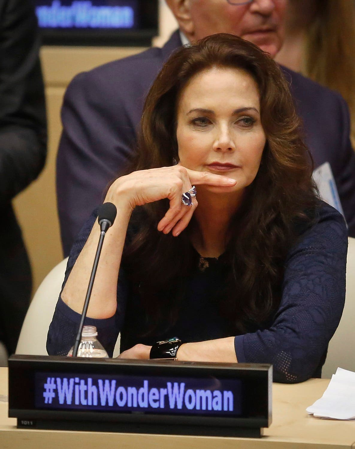 """Lynda Carter, who played Wonder Woman on television, listens during a UN meeting to designate Wonder Woman as an """"Honorary Ambassador for the Empowerment of Women and Girls,"""" (Photo: AP/Bebeto Matthews)"""