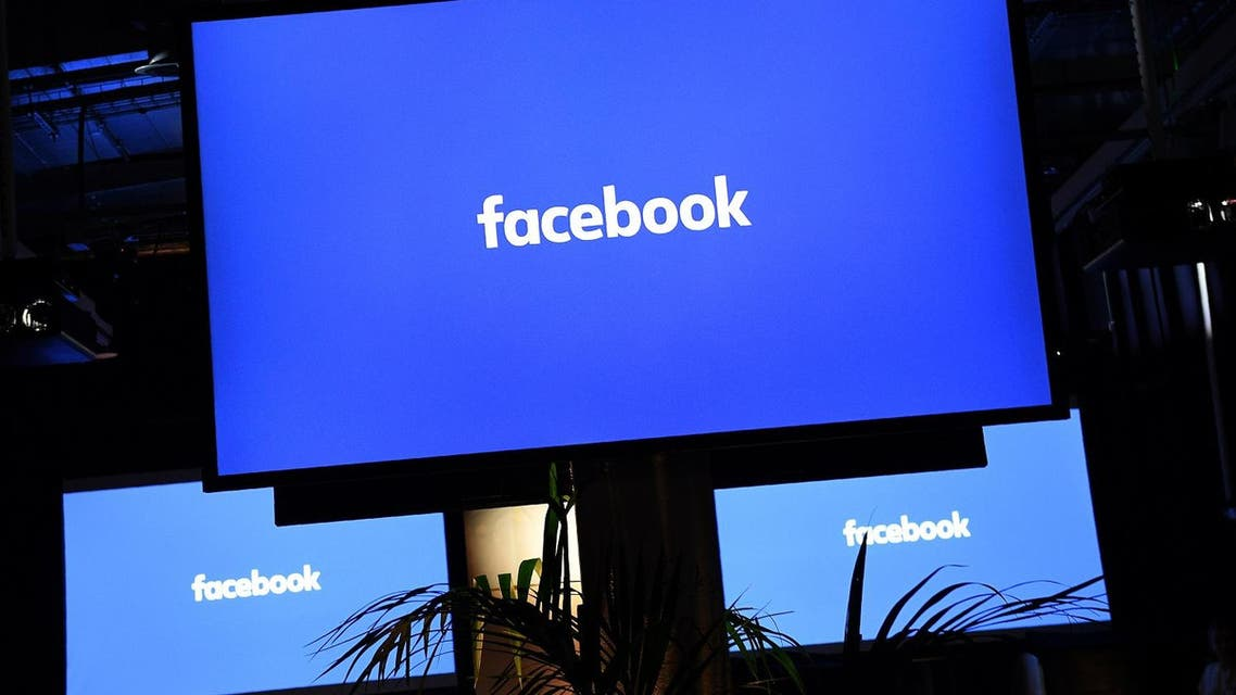 "A Facebook logo is pictured on a screen ahead of a press conference to announce the launch of it's latest product ""Workplace"", in central London on October 10, 2016. Social network giant Facebook launched new global product Workplace, a platform that it hopes will replace intranet, mailbox and other internal communication tools used by businesses worldwide. It is intended to compete with similar office communication products including Microsoft's Yammer, Salesforce's Chatter and Slack.  Justin TALLIS / AFP"