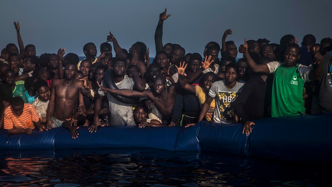 In this photo taken on Saturday Sept. 10, 2016, African refugees and migrants react aboard a partially punctured rubber boat as they wait to be assisted by a NGO, non-governmental organization members, during a rescue operation on the Mediterranean Sea, about 13 miles North of Sabratha, Lybia, (AP Photo/Santi Palacios)