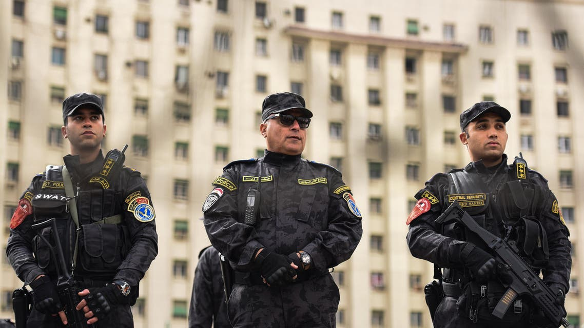 Members of the Egyptian police special forces stand guard on Cairo's landmark Tahrir Square on January 25, 2016 AFP