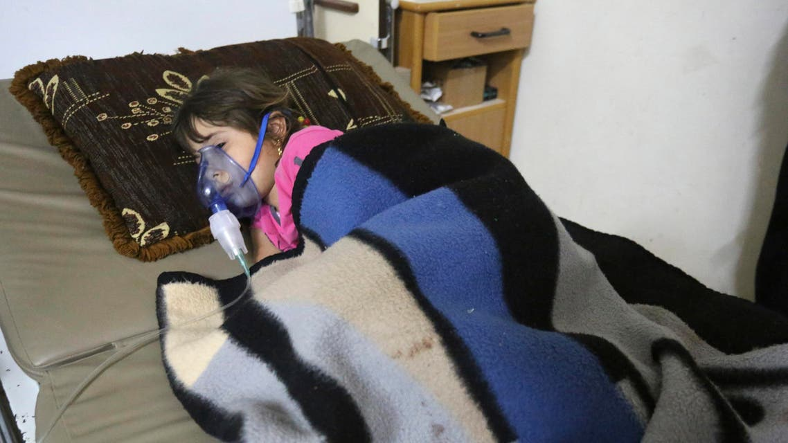 A girl, affected by what activists say was a gas attack, receives treatment inside a makeshift hospital in Kfar Zeita village in the central province of Hama May 22, 2014. (Reuters)