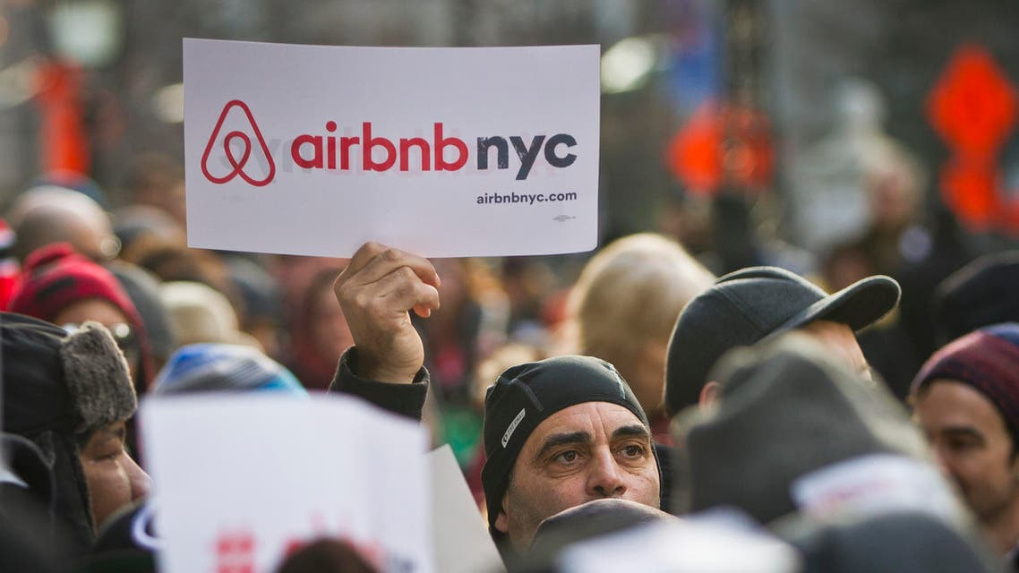 Supporters of Airbnb hold a rally outside City Hall, Tuesday, Jan. 20, 2015, in New York. With home-as-hotel sites like Airbnb doing booming business, New York City lawmakers are holding a hearing to scrutinizing how the trend affects the housing market and economy. (AP)