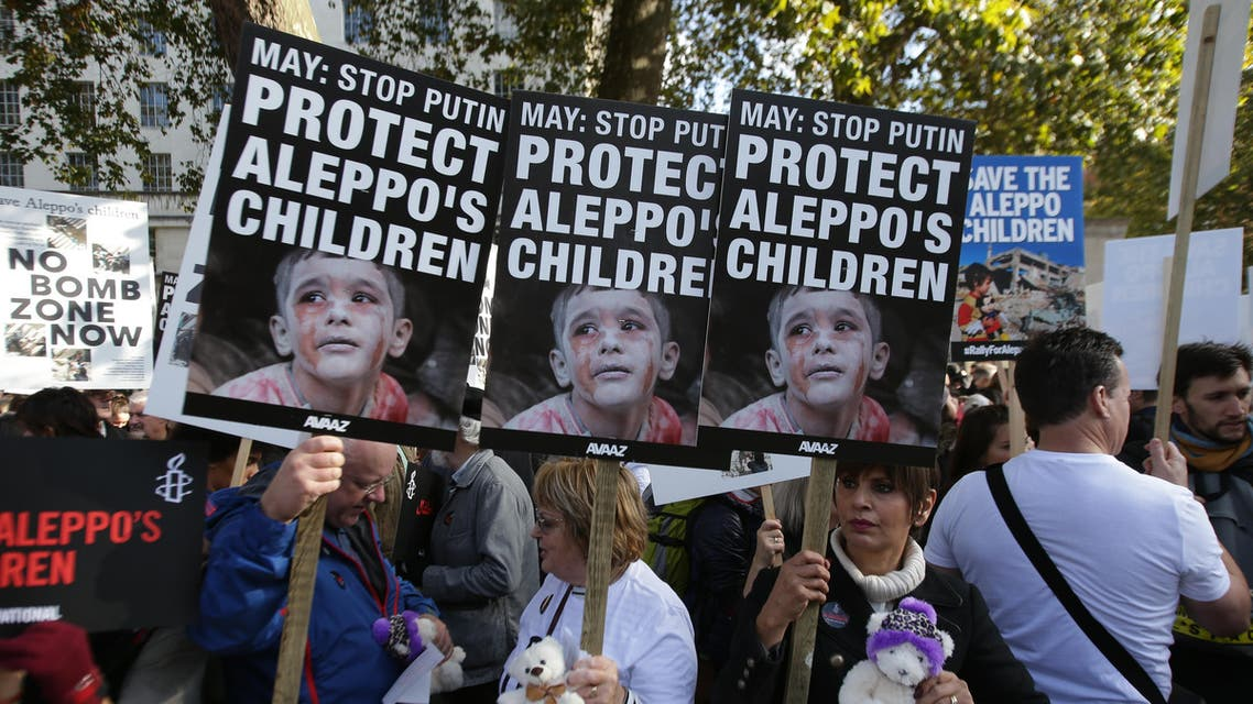 Demonstrators hold teddy bears and placards that call on British Prime Minister Theresa May to take action to protect the children of the Syrian city of Aleppo during a rally outside Downing Street in central London on October 22, 2016. Several campaign groups and charities including Avaaz and Amnesty International organised a rally outside Downing Street in London to call on the British government to set out a plan to protect Syrian children in the embattled Syrian city of Aleppo. Hundreds of wounded civilians were stranded in rebel-held areas of Syria's Aleppo on October 22 after the UN said security concerns had prevented evacuation convoys even as Russia extended a ceasefire into a third day. AFP
