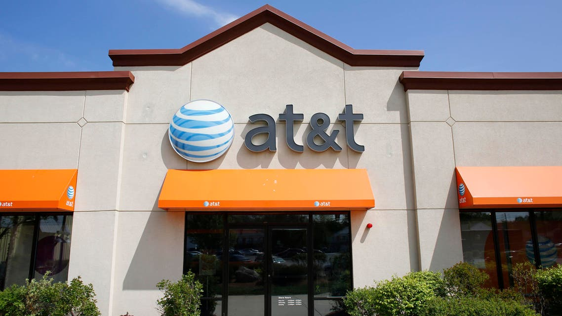 In this Wednesday, May 14, 2014 photo an AT&T logo is attached to the exterior of a store location in Dedham, Mass. (AP)