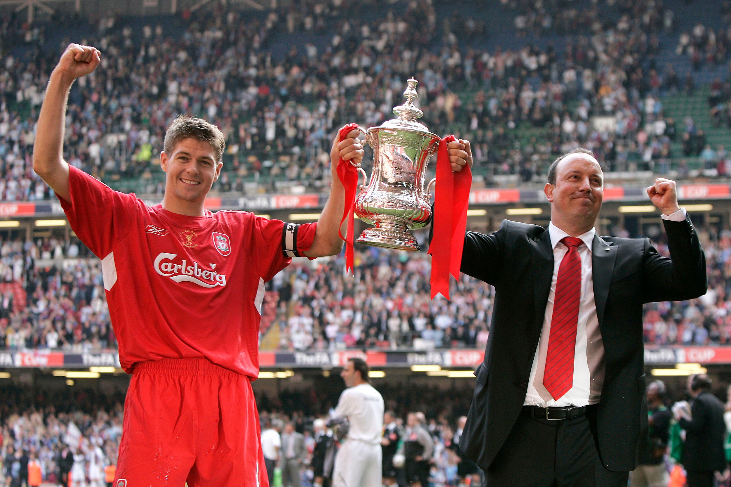 Liverpool's Steven Gerrard, left, and manager Rafael Benitez celebrate their win against West Ham United in the FA Cup Final soccer match with the trophy at the Millennium Stadium in Cardiff, Wales, Saturday, May 13, 2006. Liverpool won 3-1 on penalties after the match ended 3-3 after extra time. (AP)