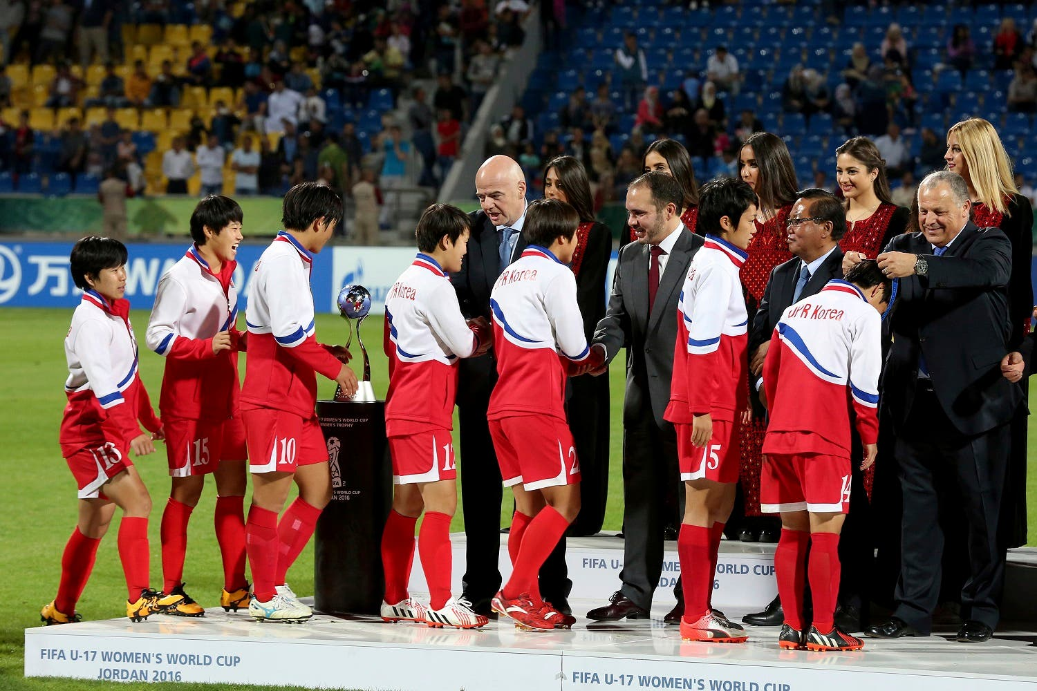 FIFA President Gianni Infantino, center, award North Korean players the gold medals, after North Korea won the final game against Japan at the FIFA U-17 Women's World Cup at Amman International Stadium in Amman, Jordan, Friday, Oct. 21, 2016. (Photo AP/Raad Adayleh)