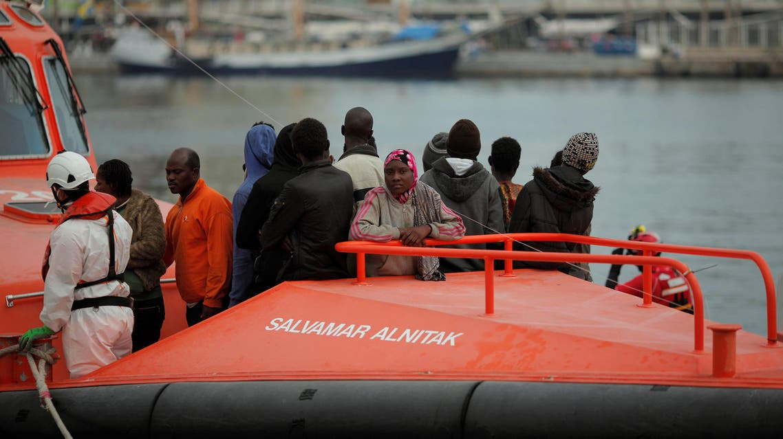 Migrants, who are part of a group intercepted aboard a dinghy off the coast in the Mediterranean sea, stand on a rescue boat upon arriving at a port in Malaga, southern Spain, October 22, 2016. REUTERS