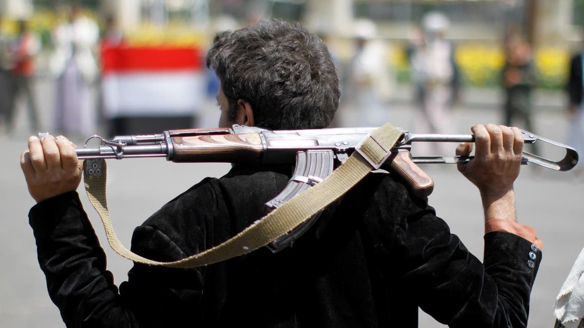 An armed man loyal to the Houthi movement holds his weapon as he gathers to protest against the Saudi-backed exiled government deciding to cut off the Yemeni central bank from the outside world, in the capital Sanaa, Yemen August 25, 2016. REUTERS
