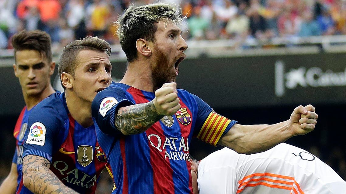 FC Barcelona's Lionel Messi celebrates after scoring a penalty during the Spanish La Liga soccer match between Valencia and FC Barcelona at the Mestalla stadium in Valencia, Spain, Saturday, Oct. 22, 2016. (AP