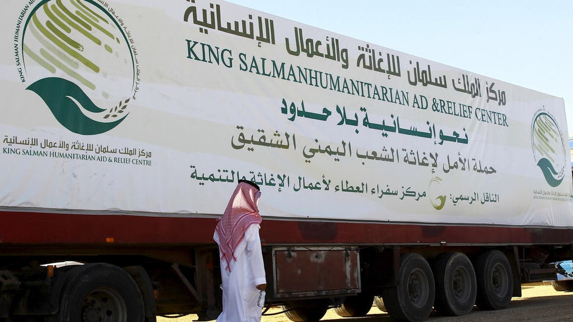 A saudi man walks next to a truck loaded with aid offered by King Salman Center for Relief and Humanitarian Aid to be sent to the Yemeni people, in Riyadh April 17, 2016. REUTERS