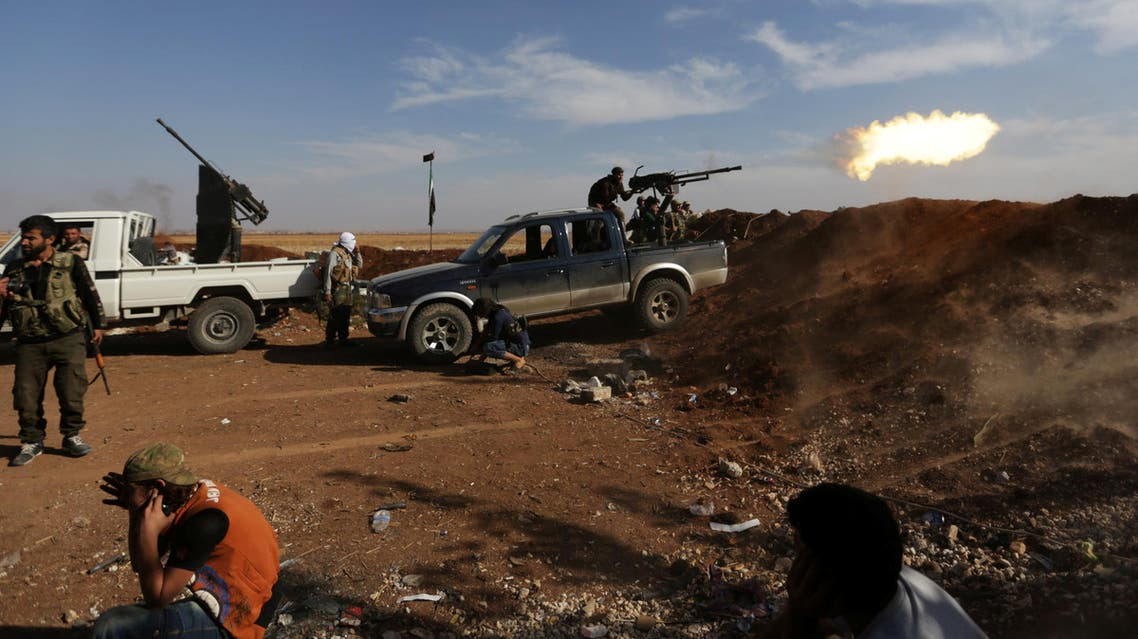 Rebel fighters in Marea city shoot a weapon towards Syria Democratic Forces (SDF) controlled Tell Rifaat town, northern Aleppo province, Syria October 21, 2016. REUTERS