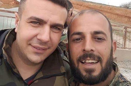 القتيل إلى اليمين مع أحد إعلاميي فضائية النظام السوري