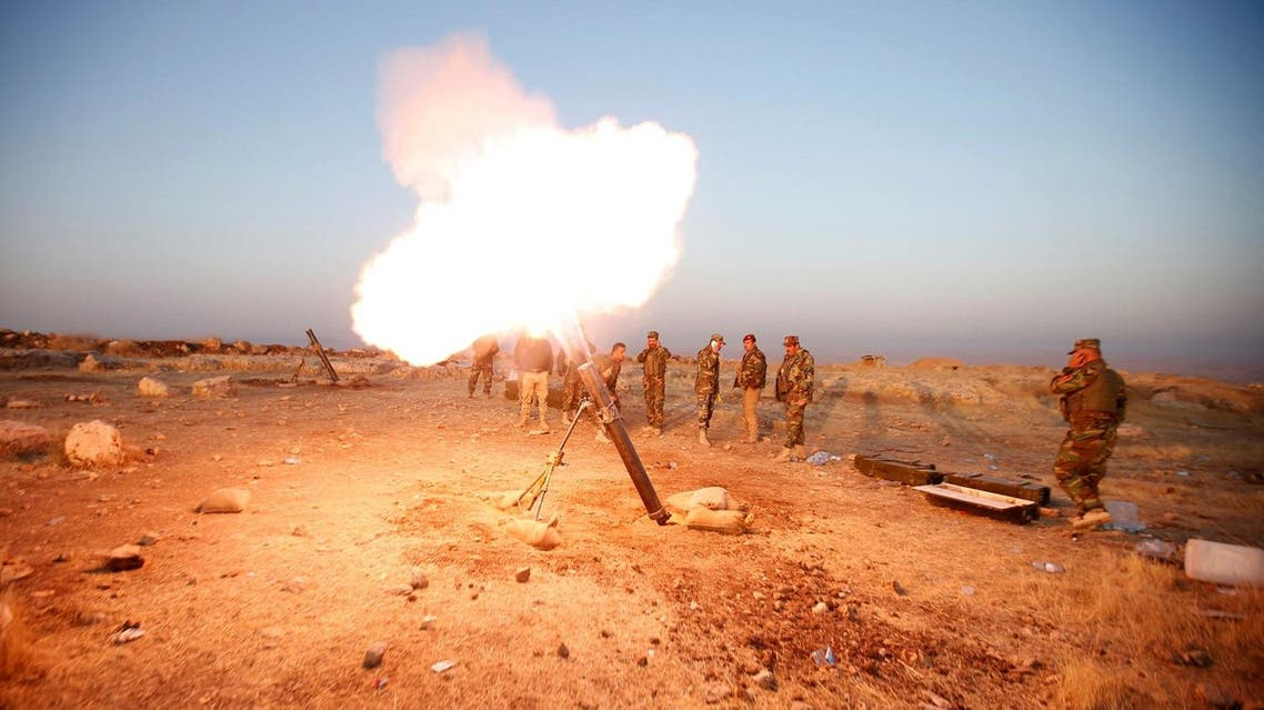 Peshmerga forces fires a mortar towards ISIS militants' positions in the town of Naweran. (Reuters)