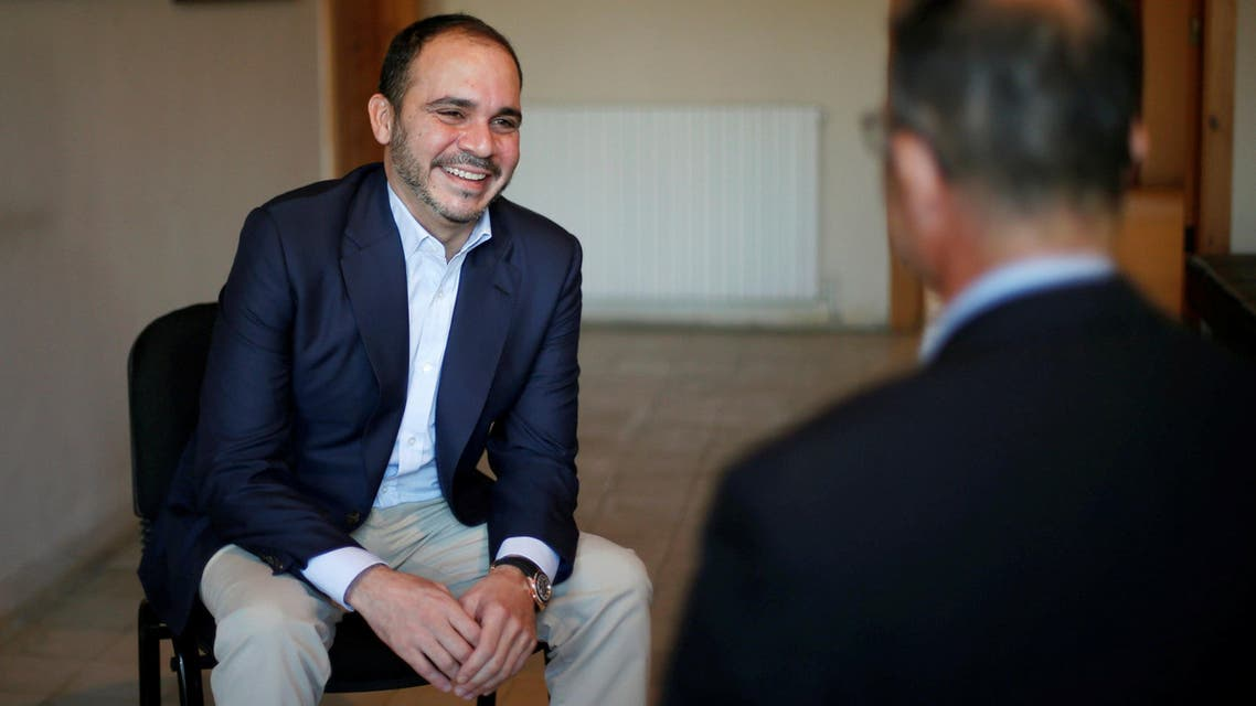 Jordan's Prince Ali Bin Al Hussein (left), president of the Jordanian Football Association, laughs with Reuters journalist Suleiman al-Khalidi after the end of the interview, in Amman, Jordan, on October 23, 2016. (Reuters)