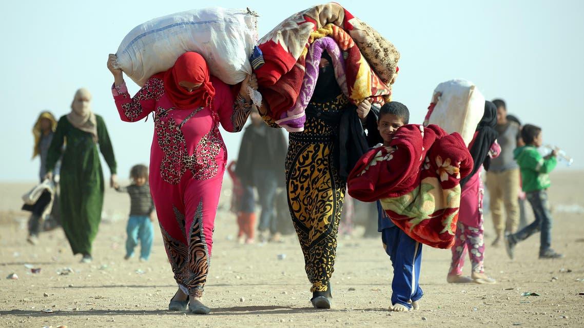 نازحون عراقيون تركوا بيوتهم بعد معركة الموصل - فرانس برس
