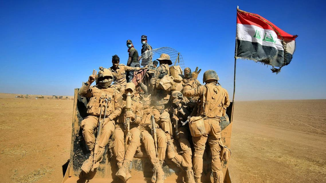 US-backed Iraqi forces fought their way inside two villages on Monday as they crept closer to Mosul. (AFP)