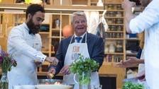 German president prepares 'tabbouleh' with Syrian refugee