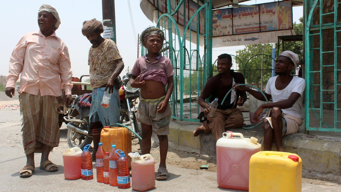 Yemenis sell petrol on the street after Yememi government forces re-entered Zinjibar the capital of the southern Abyan province on August 16, 2016 following an offensive backed by Saudi-led air strikes to recapture the city from Al-Qaeda jihadists. Government forces re-entered the provincial capital of Abyan on August 14 after clashes with Al-Qaeda jihadists who have exploited a power vacuum in Yemen to expand their presence in the country's south and southeast. AFP