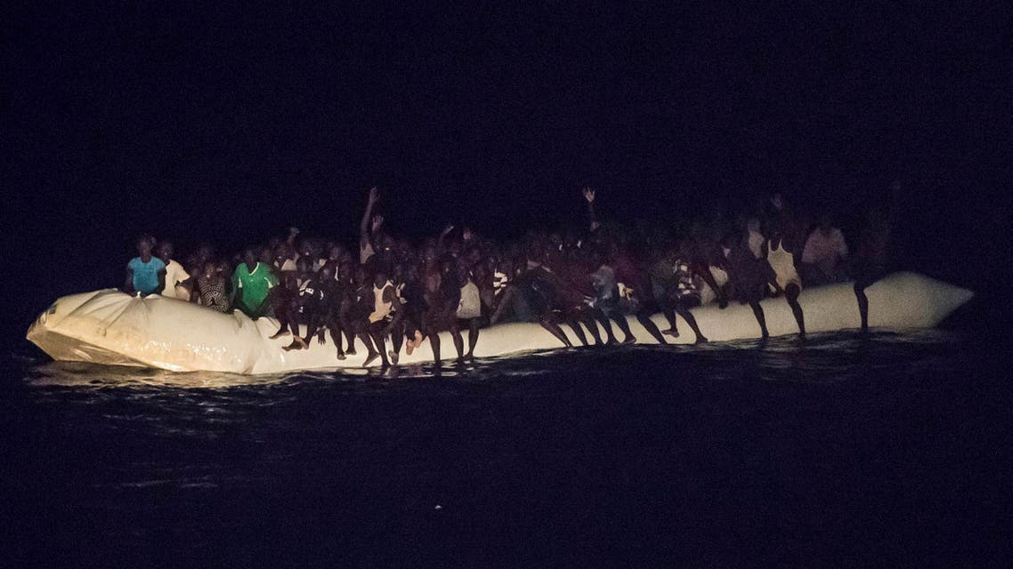 In this Oct. 21, 2016 picture provided by Sea-Watch aid group, refugees sit in a inflatable boat off the Libyan coast in the Mediterranean Sea. AP
