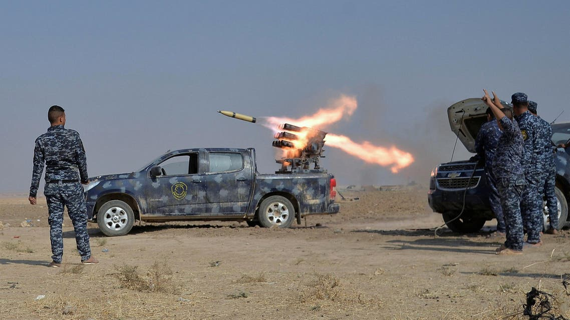 Federal police forces launch a rocket during clashes with ISIS militants in south of Mosul. (Reuters)