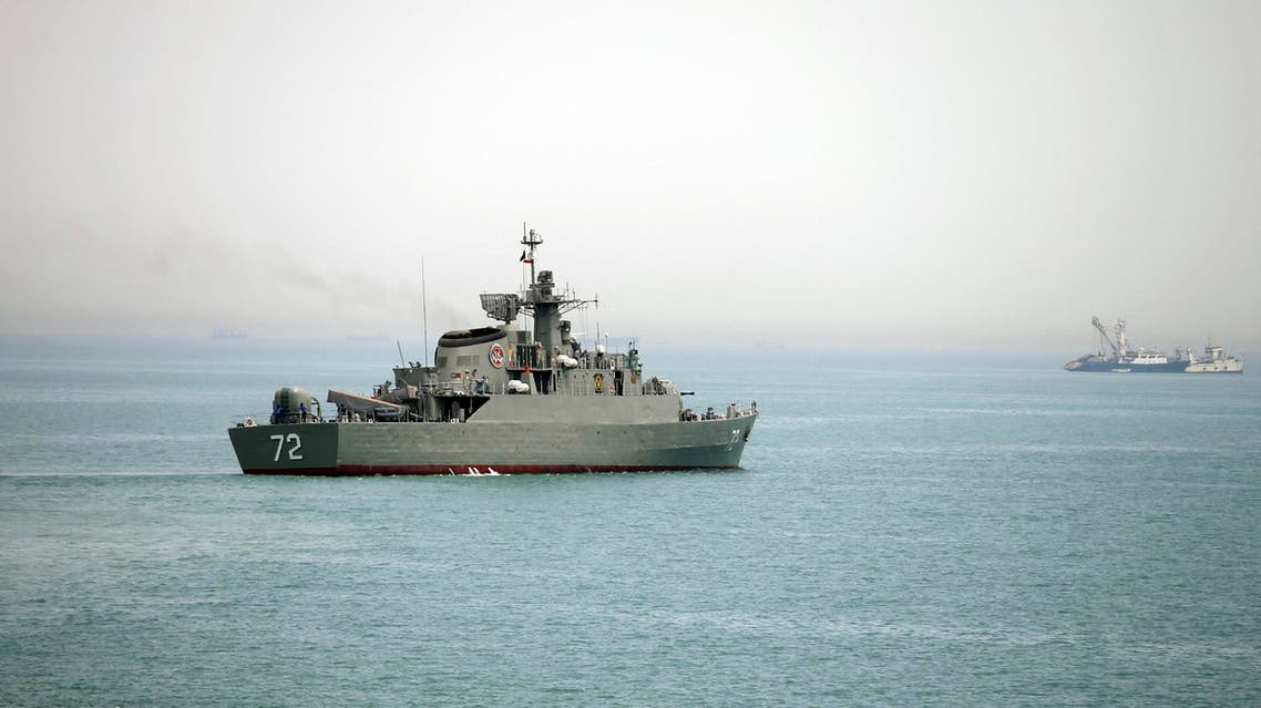 In this Tuesday, April 7, 2015, file photo released by the semi-official Fars News Agency, Iranian warship Alborz, foreground, prepares before leaving Iran's waters, at the Strait of Hormuz. AP