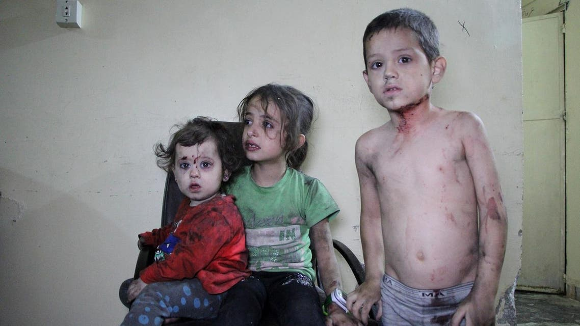 Wounded Syrian children await to receive treatment at a hospital following a reported air strike on the rebel-held northwestern city of Idlib. (File photo: AFP)