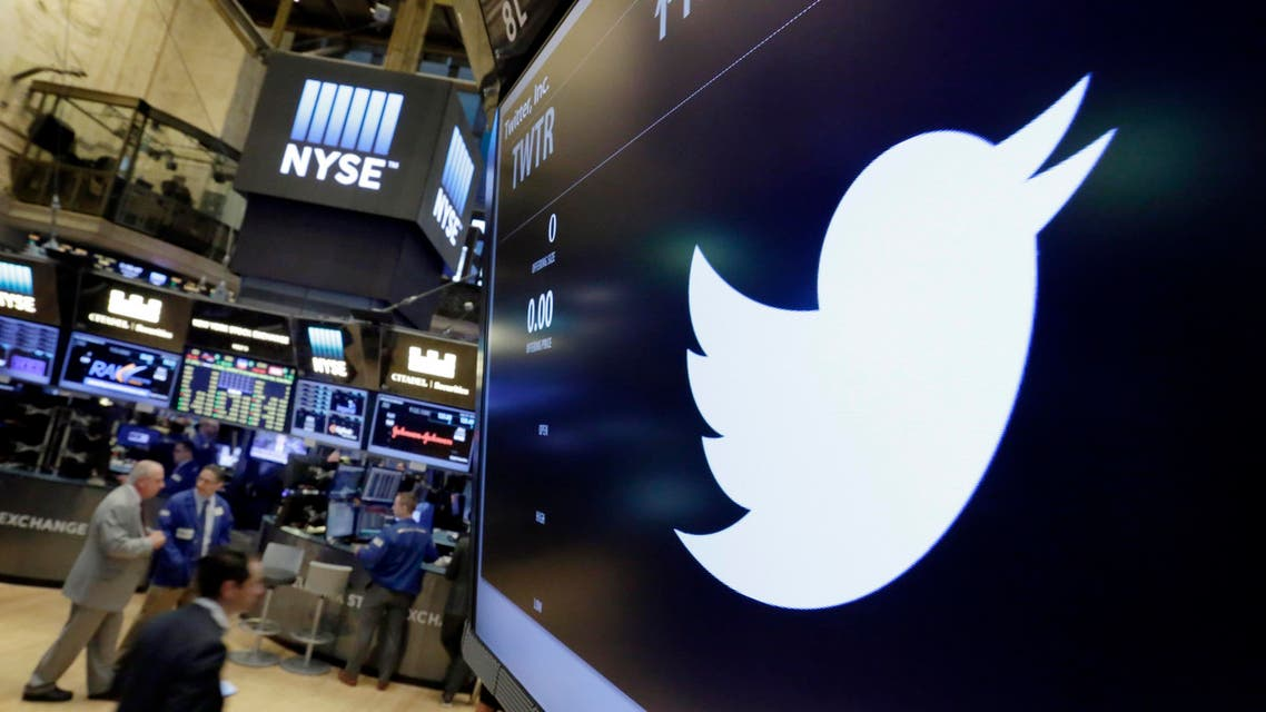 In this July 27, 2016, file photo, the Twitter symbol appears above a trading post on the floor of the New York Stock Exchange. Twitter, seemingly unable to find a buyer and losing money, is cutting about 9 percent of its employees worldwide.