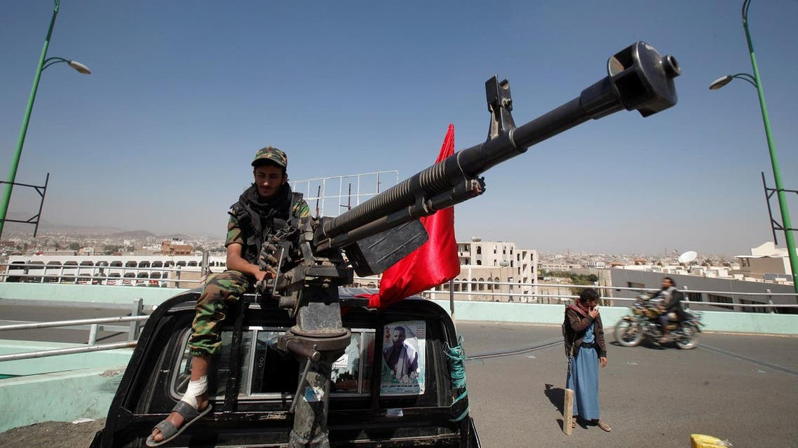 Houthi militant sits atop a police patrol truck stationed on a bridge in the capital Sanaa. (Reuters)