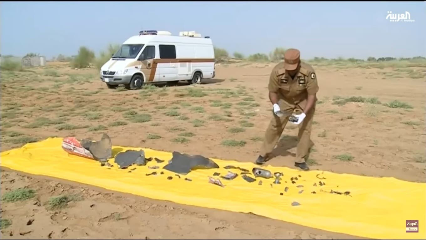 Parts of the intercepted missile reportedly launched by Houthi militias are laid down. (Al Arabiya)