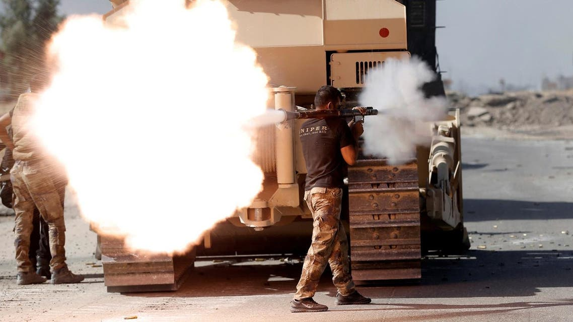 An Iraqi special forces soldier fires an RPG during clashes with Islamic States fighters in Bartella. (Reuters)