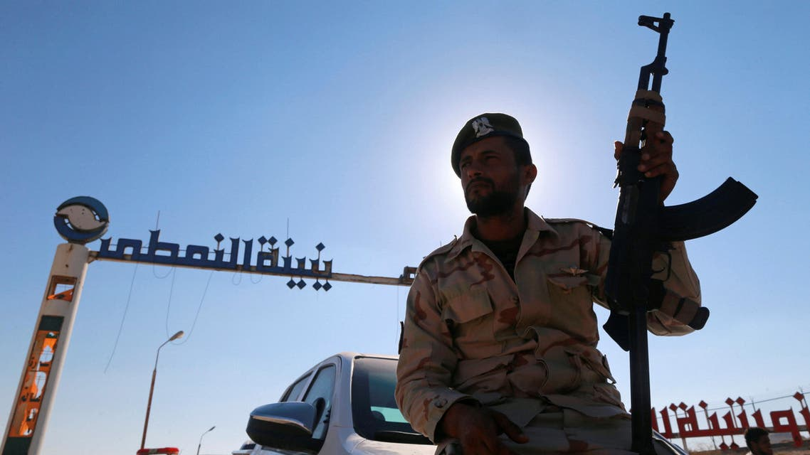 A member of Libyan forces loyal to eastern commander Khalifa Haftar holds a weapon as he sits on a car in front of the gate at Zueitina oil terminal in Zueitina, west of Benghazi, Libya September 14, 2016. Picture taken September 14, 2016. REUTERS
