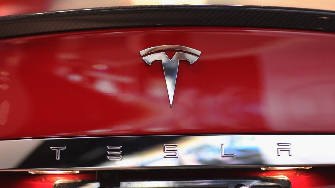 A Tesla motor company car logo sits on a car in a dealership at the Dadeland Mall on June 6, 2013 in Miami, Florida. The electric car maker is trying to make a move by selling their cars, that can cost between $62,400 and $82,400, into malls and stores. Joe Raedle/Getty Images/AFP