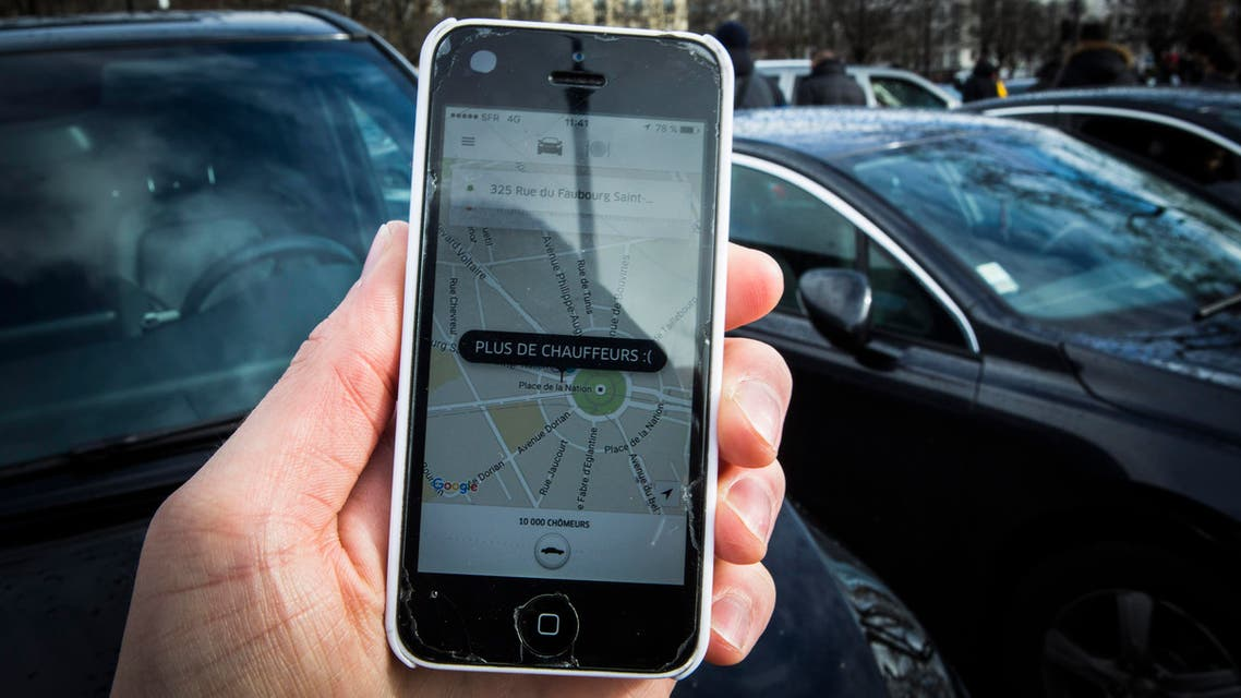 """(FILES) This file photo taken on February 9, 2016 in Paris shows a smartphone displaying the app for ride service Uber with a box reading """"No more drivers"""", as Uber suspends the app from 11am to 3pm in support of protesting non-licensed private hire cab drivers. Uber drivers in France express grievances against the US-based transport company Uber, such as degraded working conditions, low financial viability and the increasing risk of accidents. In an attempt to regulate the sector, a bill, already passed by the Parliament, will be examined in the French Senate on November 2, 2016. AFP"""