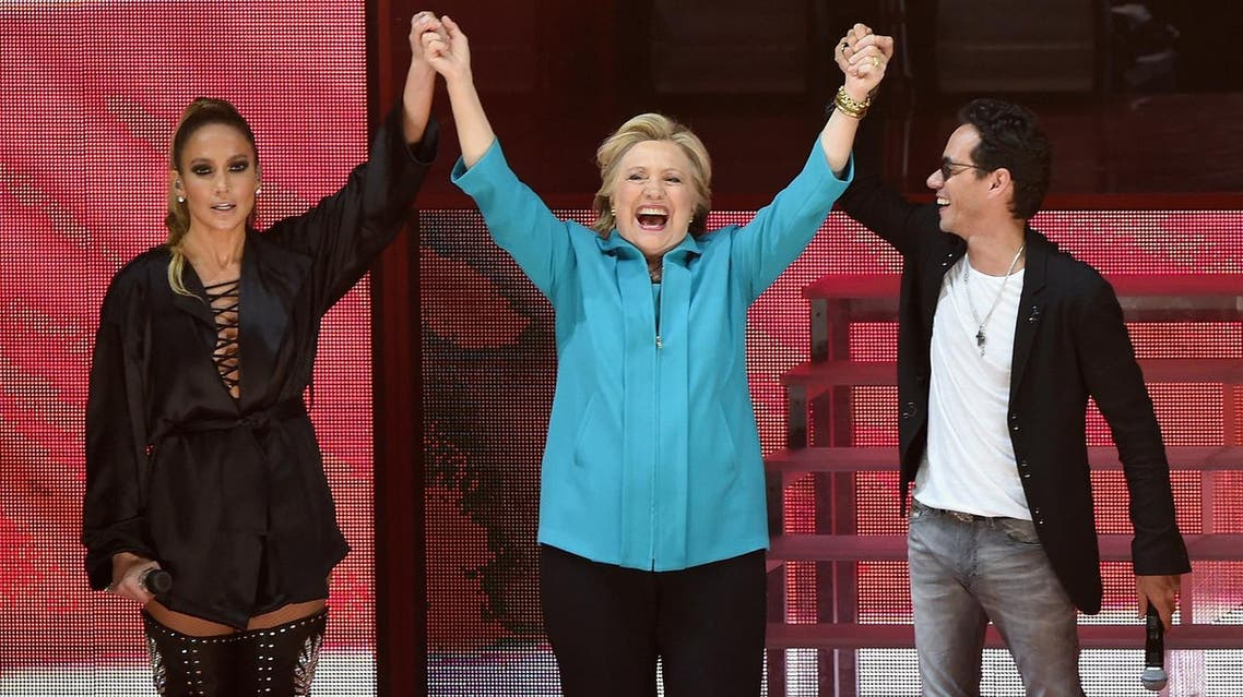afp MIAMI, FL - OCTOBER 29: Jennifer Lopez, Hillary Clinton and Marc Anthony are seen at the Jennifer Lopez Gets Loud for Hillary Clinton at GOTV Concert in Miami at Bayfront Park Amphitheatre on October 29, 2016 in Miami, Florida. Gustavo Caballero/Getty Images/AFP
