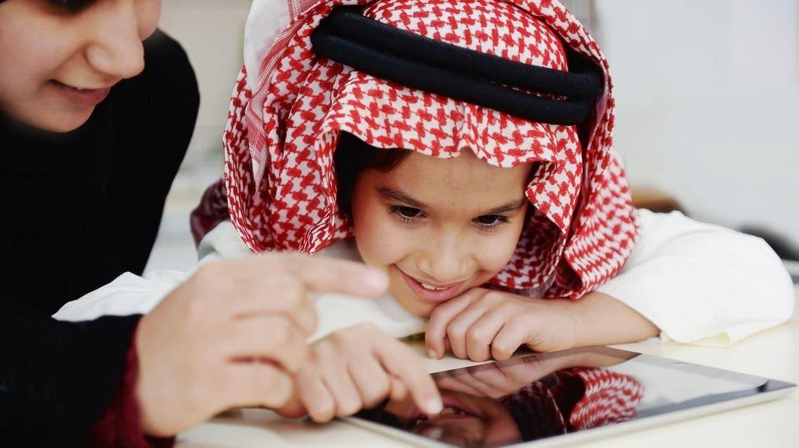 child iPad shutterstock