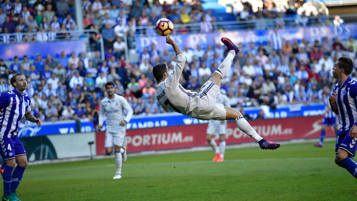 Cristiano Ronaldo answered his critics with a hat-trick as Real Madrid came from behind to win 4-1 at Alaves and go two points clear at the top. (AP)