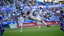 Ronaldo hat-trick keeps Real Madrid top