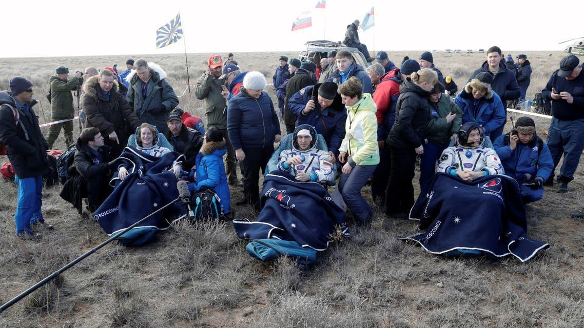 ISS crew members Rubins of U.S., Ivanishin of Russia and Onishi of Japan rest shortly after landing near Dzhezkazgan. (ReuterS)