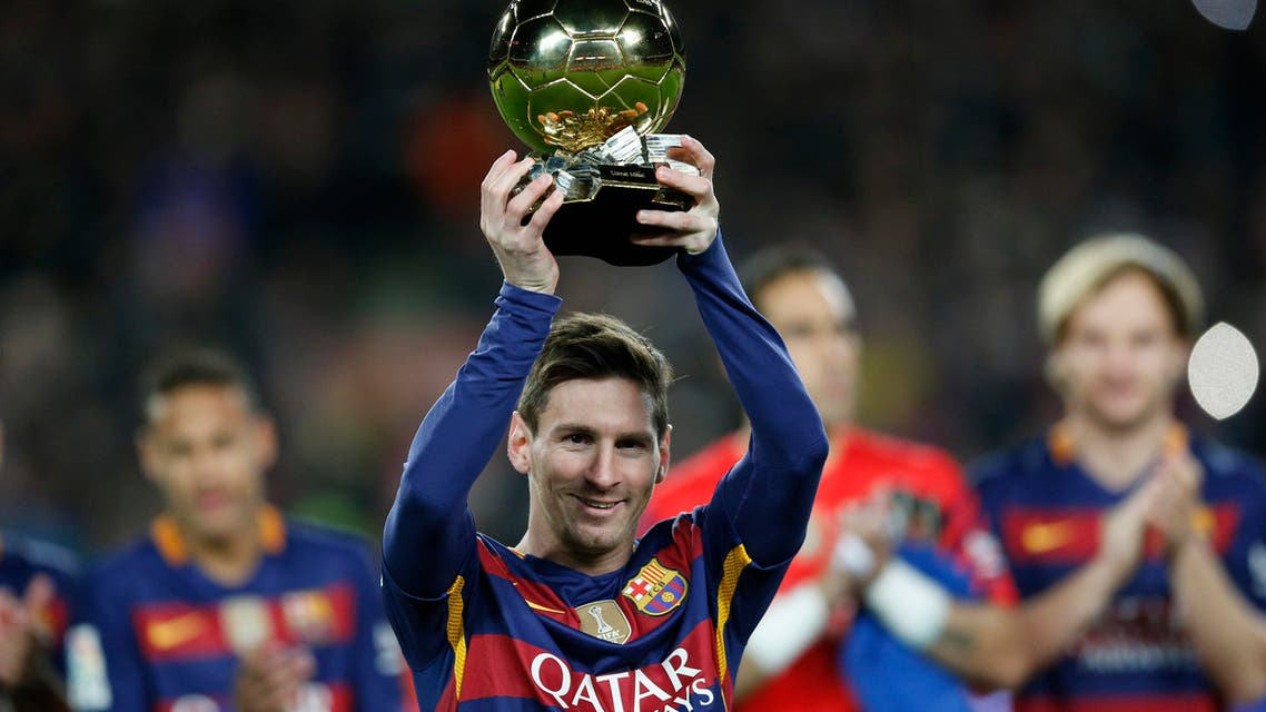 FC Barcelona's Lionel Messi, from Argentina, holds up his Ballon d'Or (Golden Ball) award as European Footballer of the Year prior the Spanish La Liga soccer match between FC Barcelona and Athletic Bilbao at the Camp Nou stadium in Barcelona, Spain, Sunday, Jan. 17, 2016. (AP)