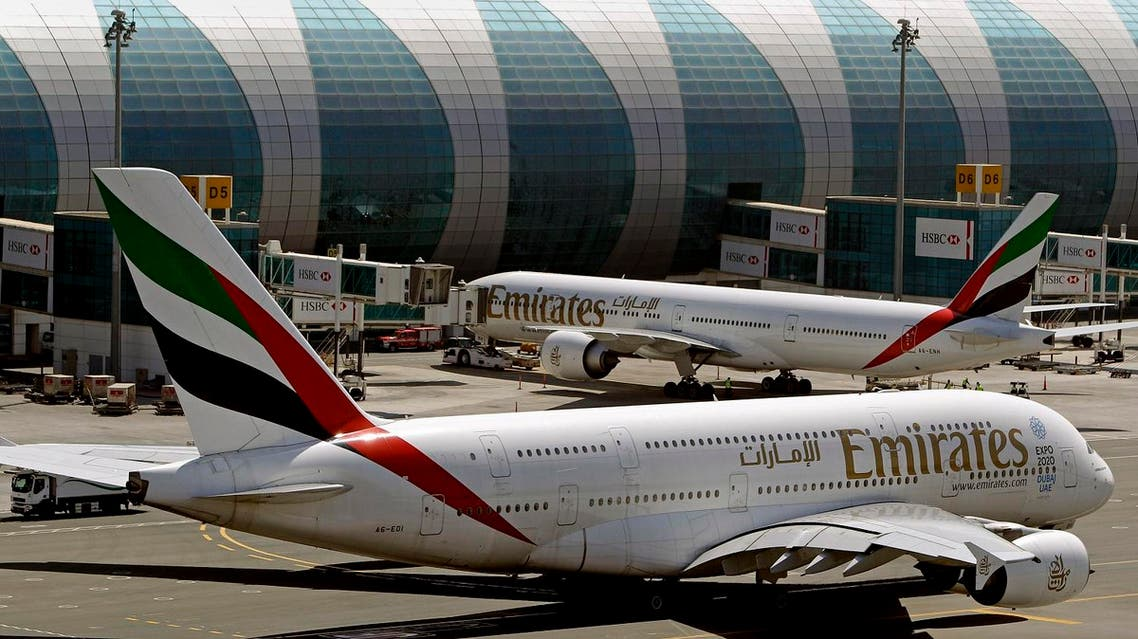 In this May 8, 2014 file photo, Emirates passenger planes are in use at Dubai airport in United Arab Emirates. Dubai Airports said Monday it plans to add 10 more A380 gates with air bridges at Dubai International Airport's Concourse C. That will leave the airport with a world record 47 gates designed for the aircraft. (AP Photo/Kamran Jebreili, File)