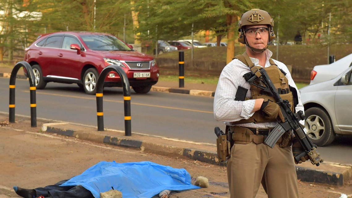 US security officers stands guard near the body of an assailant after he was shot and killed by Kenyan police outside the US embassy in the capital Nairobi on October 27, 2016, after stabbing an officer with a knife. local police chief Vitalis Otieno said the dead man was a 24-year-old Kenyan from Wajir in the country's north-east close to the border with Somalia, but did not give a name. According to police the man had been walking towards the US embassy and was close to the public entrance to the visa section when he attempted to grab a gun from one of the officers. (AFP)