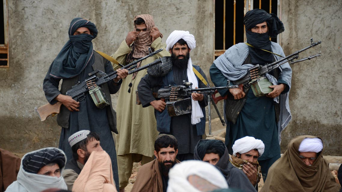 Afghan Taliban fighters listen to Mullah Mohammed Rasool, unseen, the newly-elected leader of a breakaway faction of the Taliban, in Farah province, Afghanistan. AP