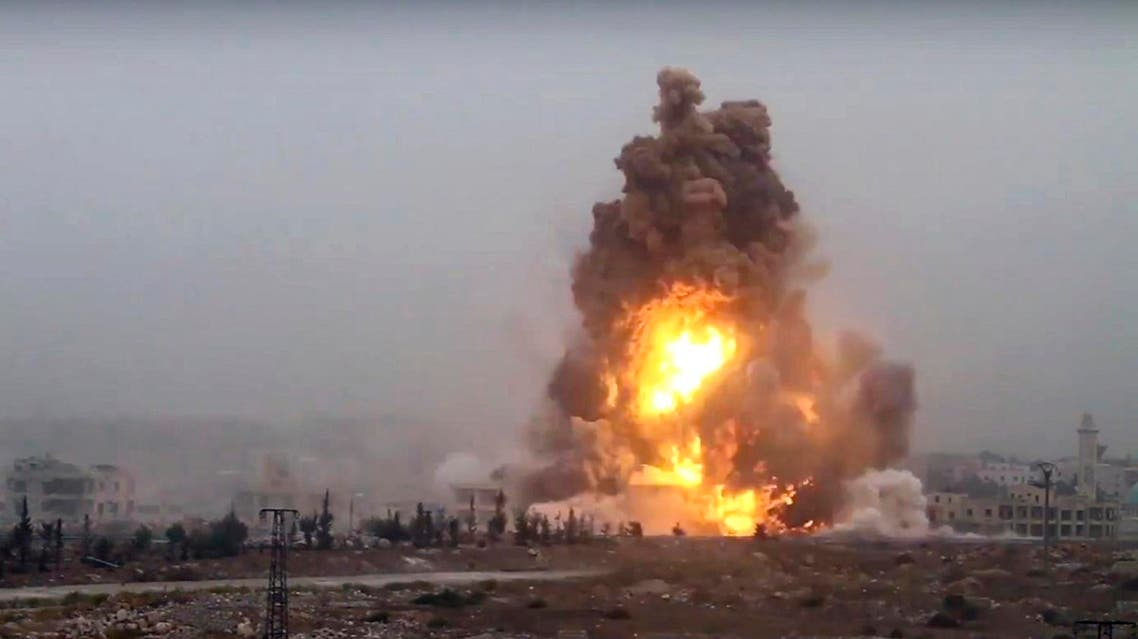 This frame grab from video provided by Thiqa news agency, a Syrian opposition media outlet that is consistent with independent AP reporting, shows flames rises from an explosive vehicle bomb that attacked a Syrian government position, in southwest of Aleppo, Syria, Friday, Oct, 28, 2016. Rebels detonating three vehicle-borne explosives against government positions to the city's southwest and attacking with hundreds of rockets, the Britain-based Syrian Observatory for Human Rights said. It said at least one of the vehicles was driven by a suicide bomber for the al-Qaida-linked Fatah al-Sham Front, which also announced the offensive. (Thiqa News Agency, via AP)