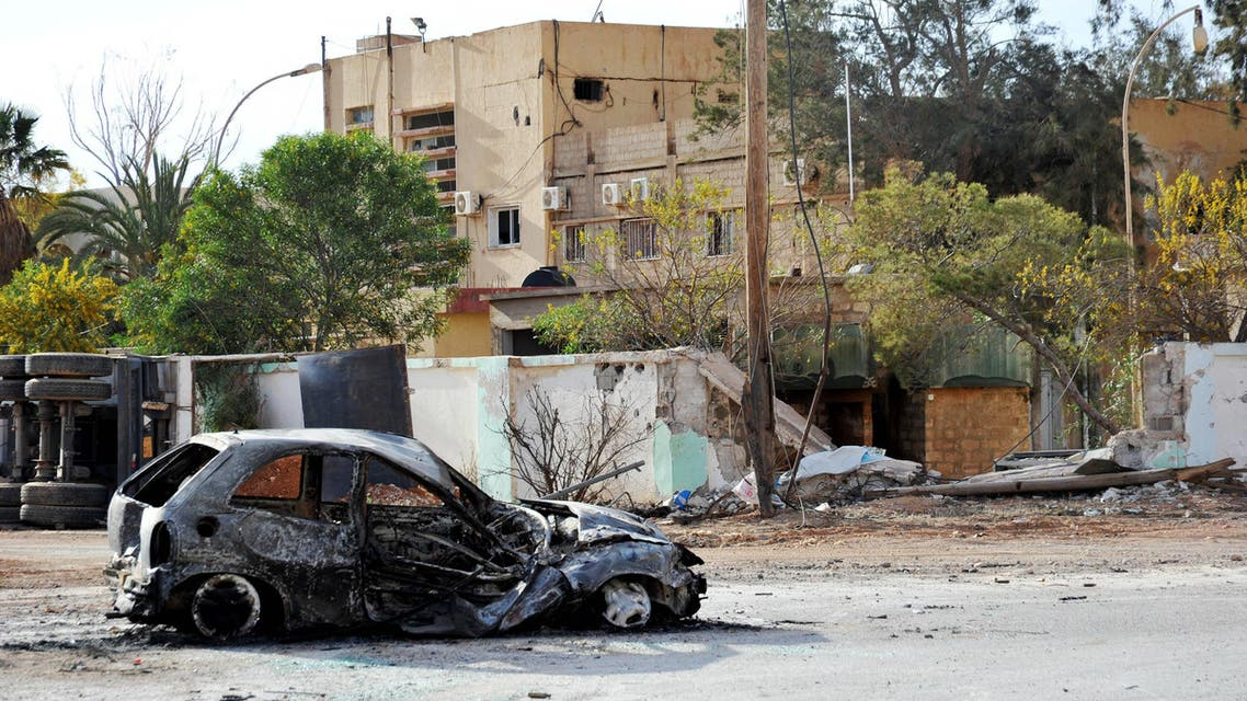In this March 10, 2016 file photo, damaged buildings and a burnt out car are seen in the Hawari area, south-west of the city of Benghazi, Libya. AP