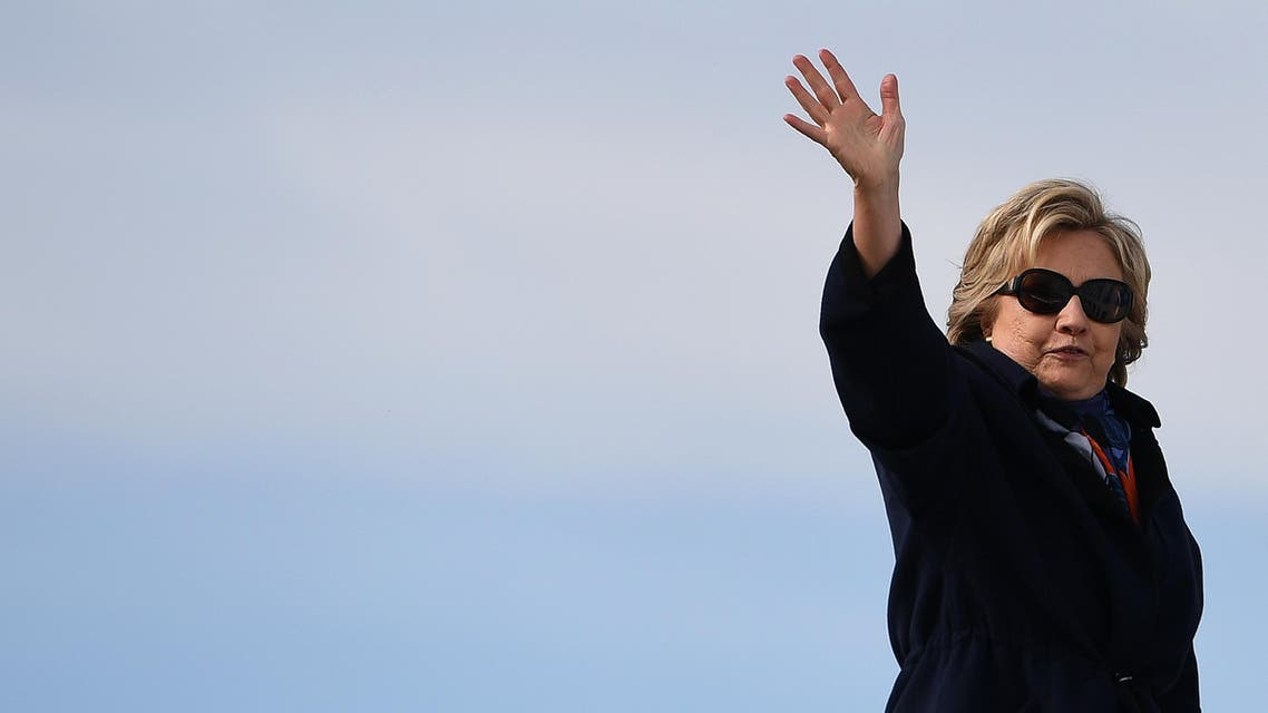US Democratic presidential nominee Hillary Clinton waves as she boards her campaign plane at the Westchester County Airport in White Plains, New York, on October 29, 2016. Clinton embarks this weekend on the frenetic final 10 days of her White House campaign, determined to shake off renewed controversy over the FBI probe into her private emails. The 69-year-old Democrat -- vying to become America's first female president -- is still the frontrunner to win the November 8 election over her Republican rival Donald Trump. (AFP)