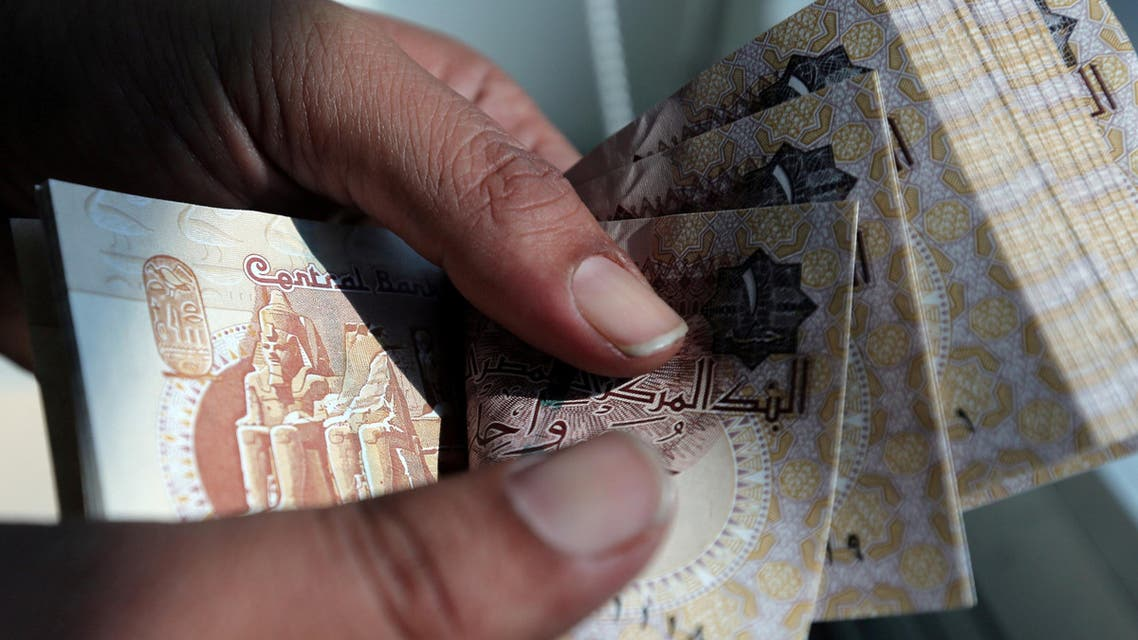 A man counts Egyptian pounds outside a bank in Cairo, Egypt October 24, 2016. reuters