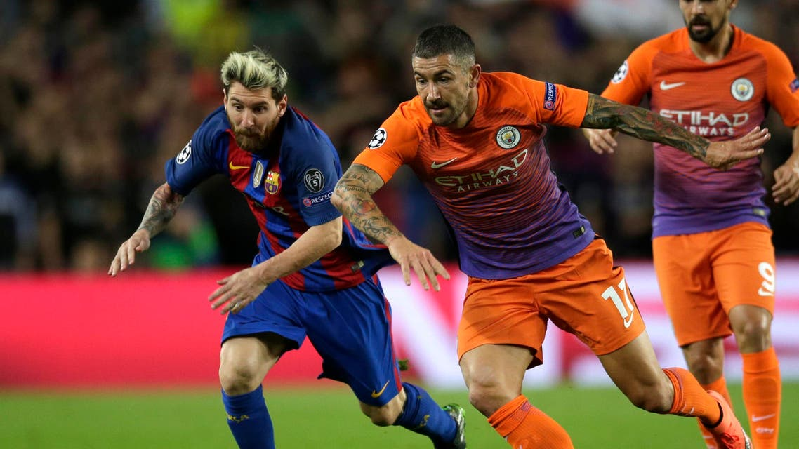 Barcelona's Lionel Messi fights for the ball against Manchester City's Aleksandar Kolarov during a Champions League, Group C soccer match between Barcelona and Manchester City, at Camp Nou stadium in Barcelona, Wednesday, Oct. 19, 2016. (AP