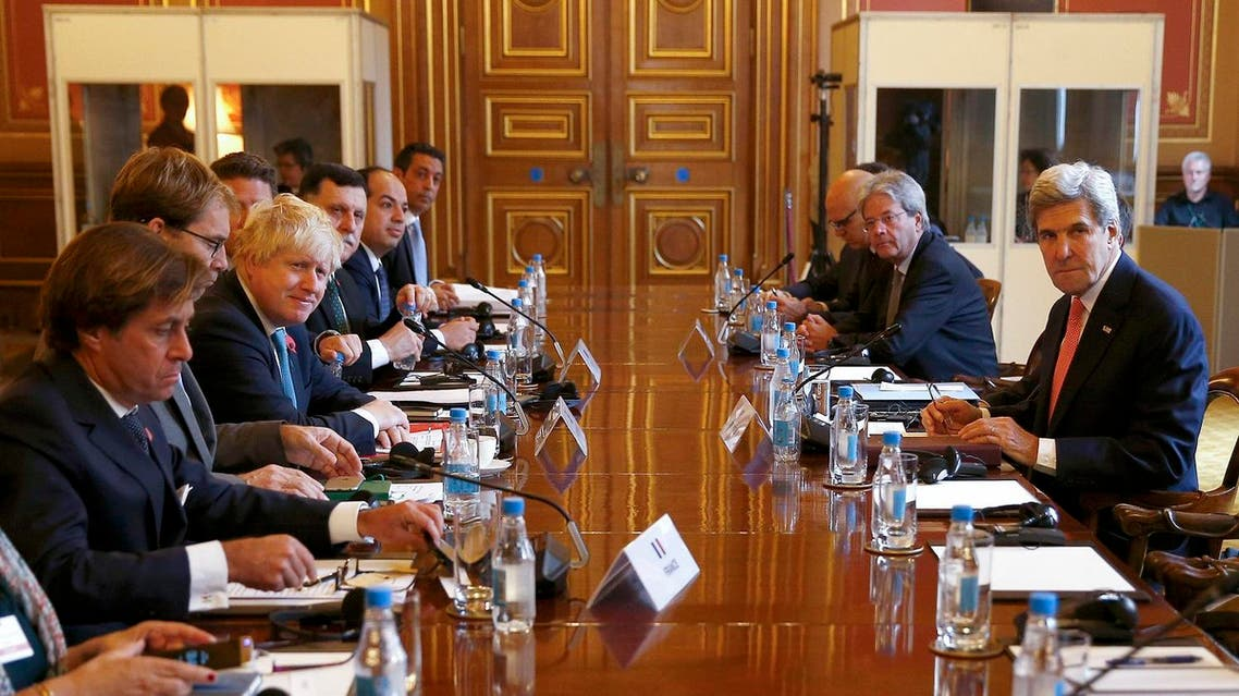 US Secretary of State John Kerry (R) attends the Libyan Ministerial meeting with Britain's Foreign Secretary Boris Johnson (3L) (Photo: Peter Nicholls/AFP)