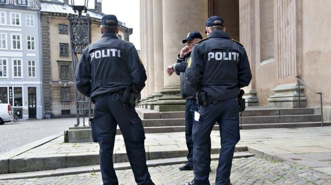 Danish police stand in front of Copenhagen City Court AFP